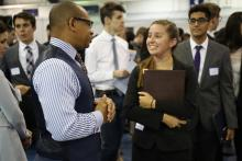 A student talks to an employer during the Career Fair