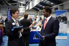 two students speaking at the career fair