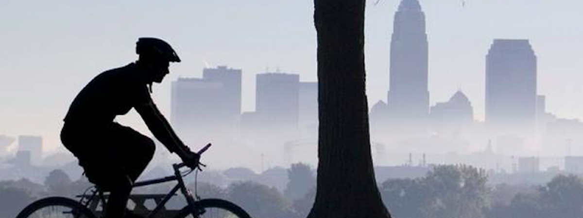 Cyclist with Cle skyline in background