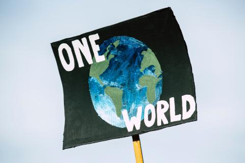 "poster with earth that says ""one world"""