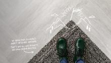 grey carpet with green shoes and white writing about carbon neutrality
