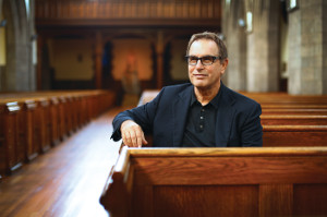 A photo of CWRU professor David Cooperrider sitting in a church pew