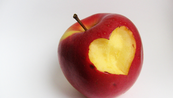apple with the shape of a heart carved in it