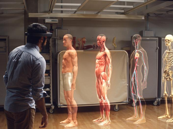 A person using HoloLens technology to view human bodies.
