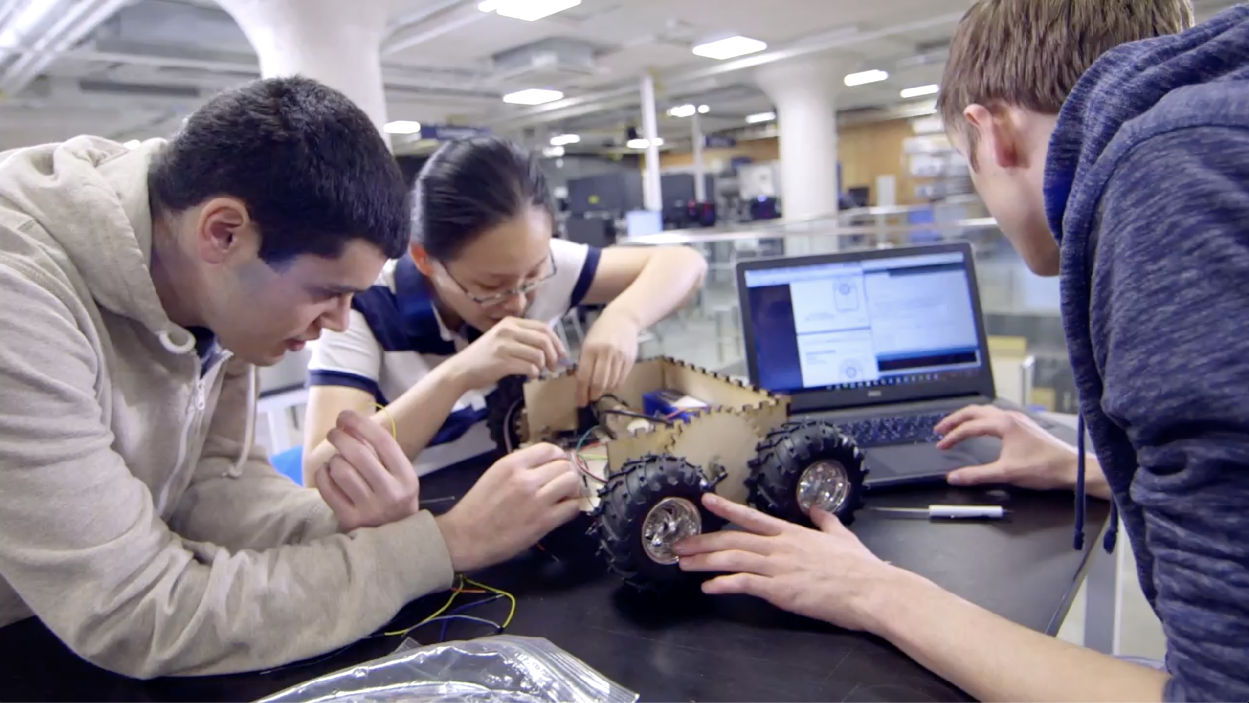 Students working on a robotic car