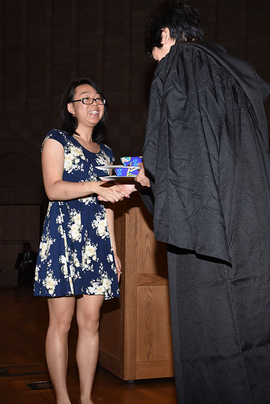 Student receiving award at Academic Awards ceremony