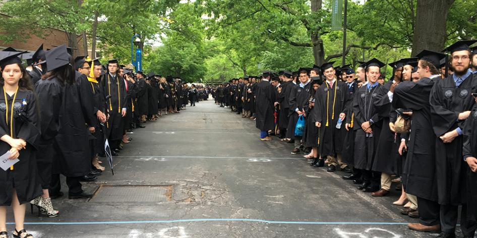 Case Western Reserve University Commencement 2017 undergraduates parting to make room for the platform party