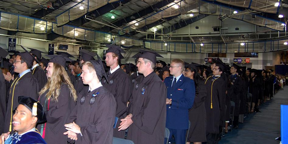 Case Western Reserve University Commencement 2017 students standing during ceremony in Veale Convocation Center