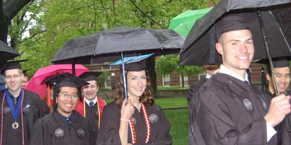 Case Western Reserve University Commencement 2016 small group of graduating students holding colorful umbrellas