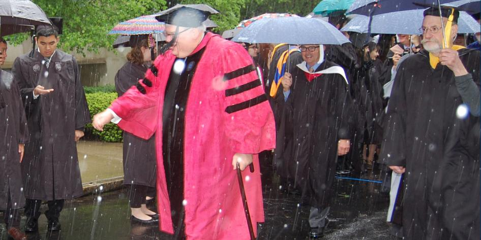 Case Western Reserve University Commencement 2016 graduating students and Dean Wolcowitz walking in snow