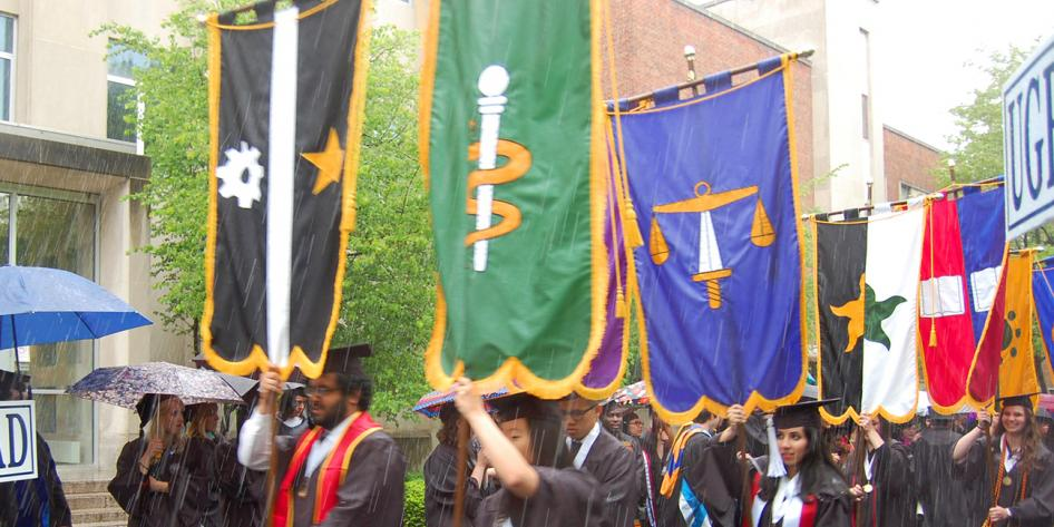 Case Western Reserve University Commencement 2016 graduating students walking with banners