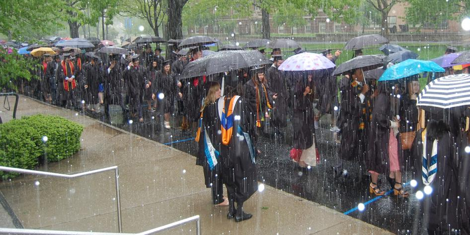 Case Western Reserve University Commencement 2016 graduating students walking on quad in snow
