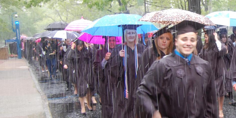 Case Western Reserve University Commencement 2016 happy graduating student in front walking in snow