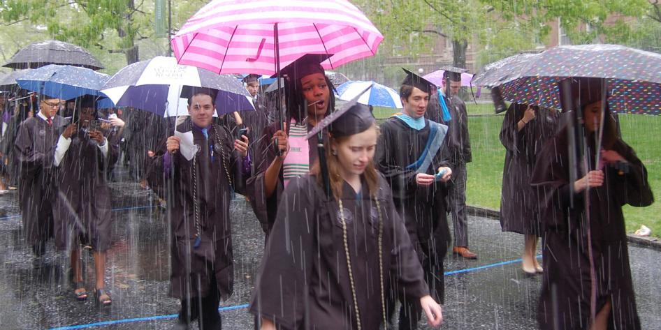 Case Western Reserve University Commencement 2016 graduating students with striped and polka dot umbrellas in snow