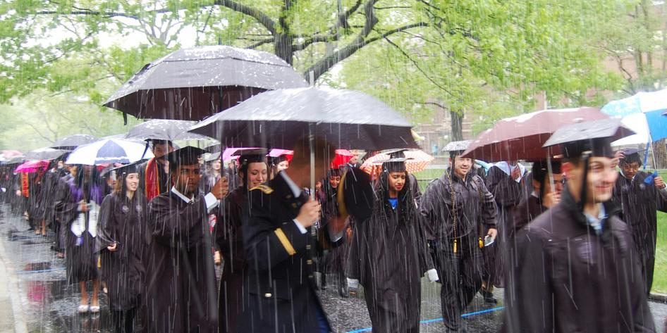 Case Western Reserve University Commencement 2016 graduating students walking in snow and man in military uniform