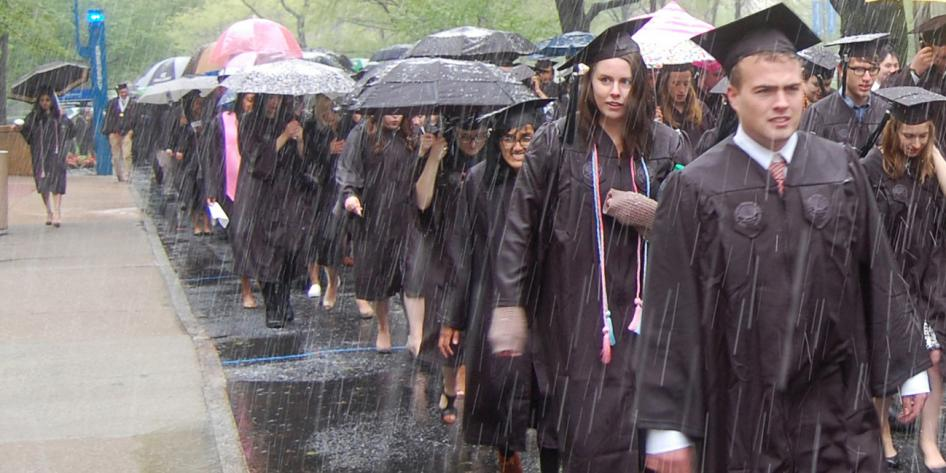 Case Western Reserve University Commencement 2016 graduating students walking in snow on quad