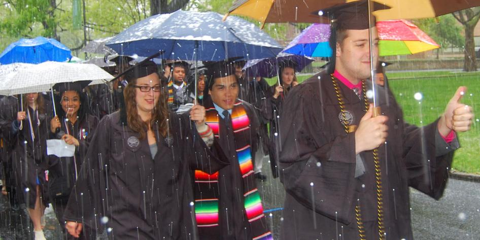 Case Western Reserve University Commencement 2016 graduating students walking in snow thumbs up