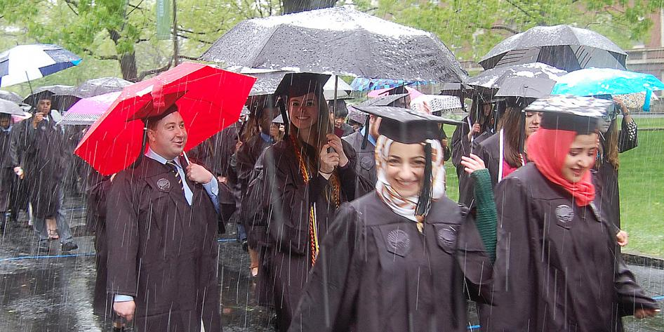 Case Western Reserve University Commencement 2016 graduating students smiling in snow outside