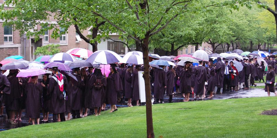 Case Western Reserve University Commencement 2016 graduating students stand outside with umbrellas