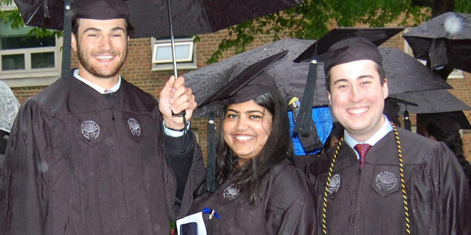 Case Western Reserve University Commencement 2016 three graduating students with umbrella