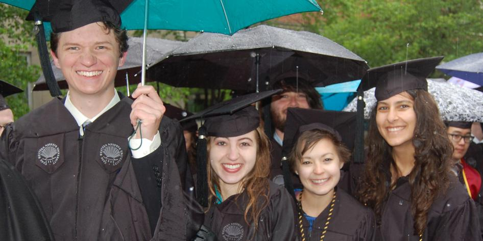 Case Western Reserve University Commencement 2016 small group of graduating students with blue and black umbrellas