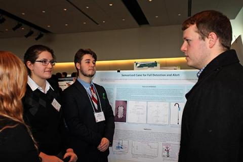 Nicholas Hazen, Grace Foxworthy, Hanna Huss, James McGinnity, and Nathaniel Landis presenting their poster