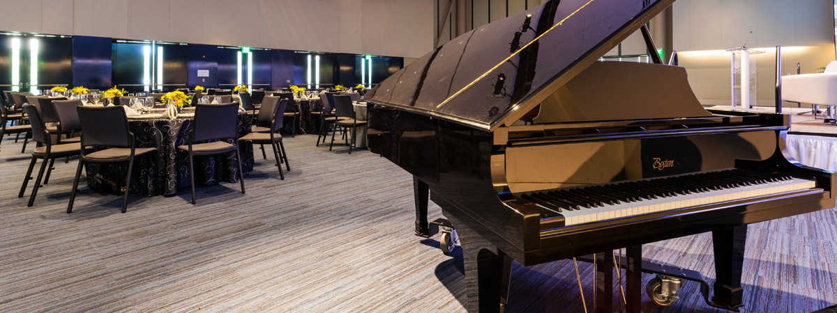 image of piano in ballroom