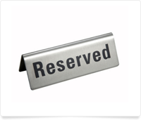 table sign saying reserved