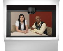 two people looking into a cisco telepresence camera