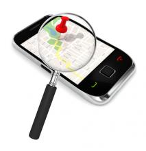 Smart phone graphic with a magifying glass over the screen which features a map app