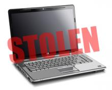 "laptop with the word ""Stolen"" superimposed"