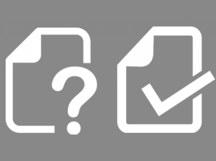 An icon with two pieces of paper, one has a question mark and one has a checkmark on it
