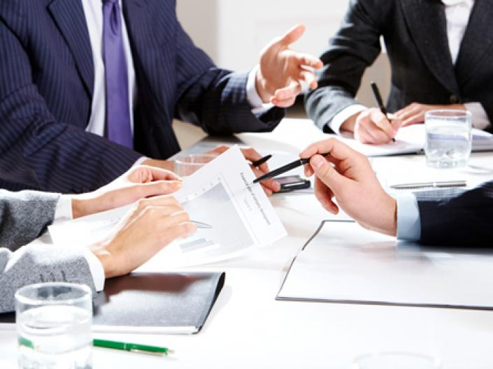Close up of hands reviewing a document at a table
