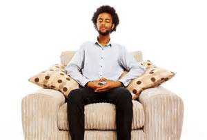 A guy sitting on a sofa