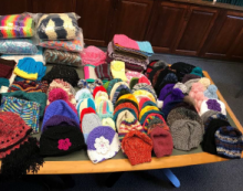 hats and gloves to donate from Crafters@Case