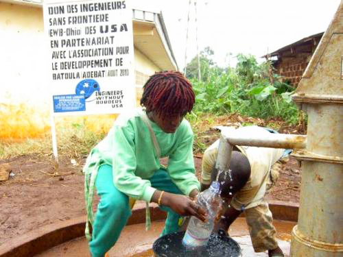 Children gather clean water from one of two water supplies built by Engineers Without Borders-Case Western Reserve University in Batoula, Cameroon, during the summer of 2010.